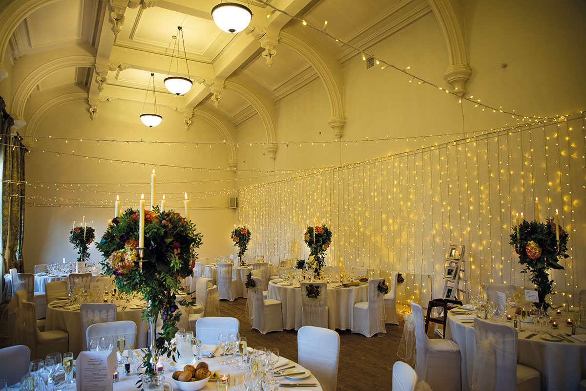 royal-botanic-garden-edinburgh-wedding-setup-with-fairylights-on-wall