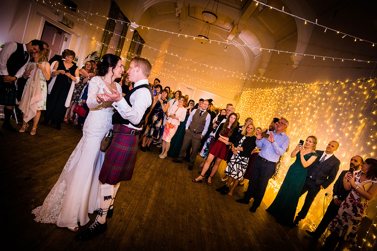 bride-and-groom-first-dance-with-groom-wearing-kilt