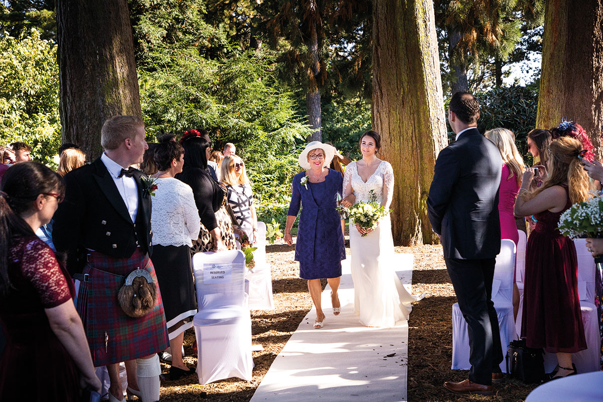 bride-given-away-by-mum-walking-down-aisle-in-forest