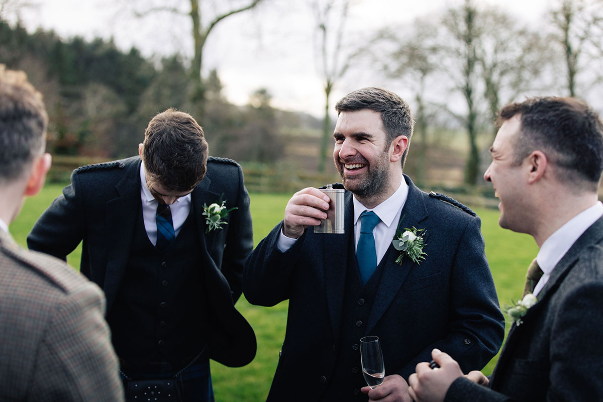 groom-and-ushers-drinking-from-hipflasks