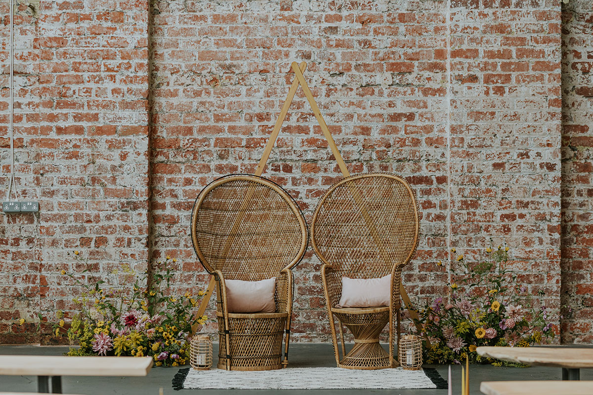 weaving-shed-dundee-peacock-chairs-and-flowers-against-brick-wall