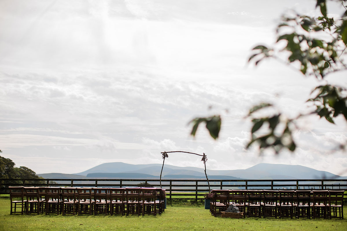 cormiston farm wedding mirrorbox photography set for outside wedding wooden chair and wooden ceremony arch