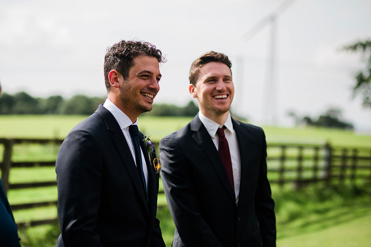 cormiston farm wedding mirrorbox photography groom and best laughing