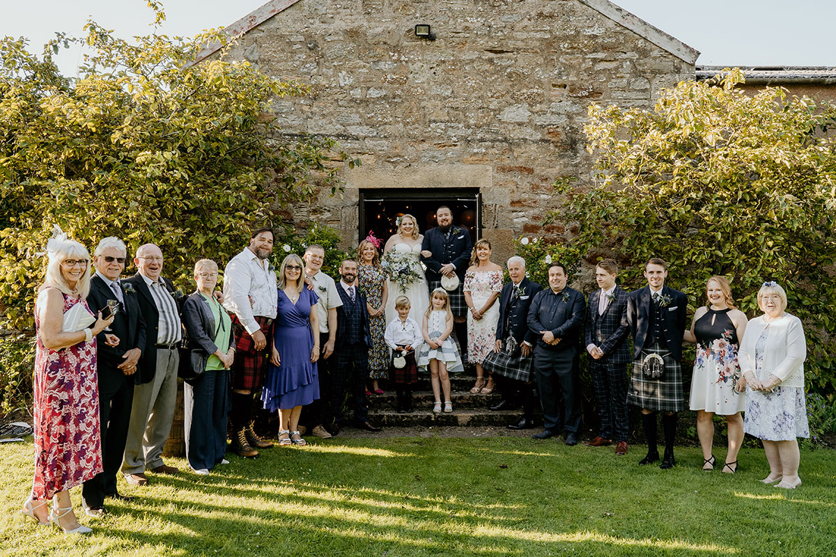 bride-groom-guests-outside-kinkell-byre-victoria-photography