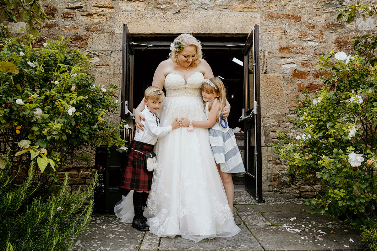bride-with-children-outside-kinkell-byre-victoria-photography