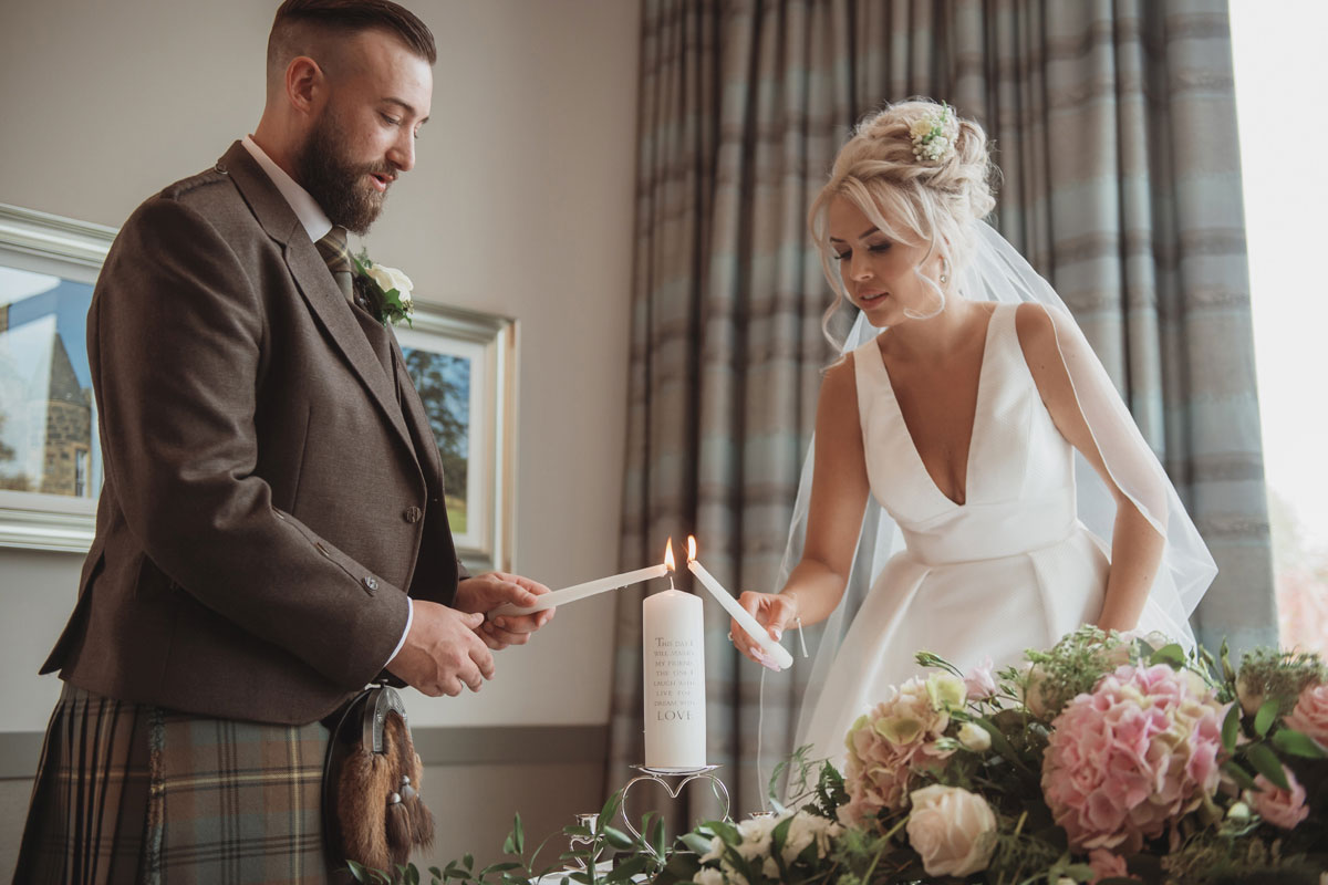 Aboyne Photographics Meldrum House Aberdeen wedding venue bride groom lighting candles