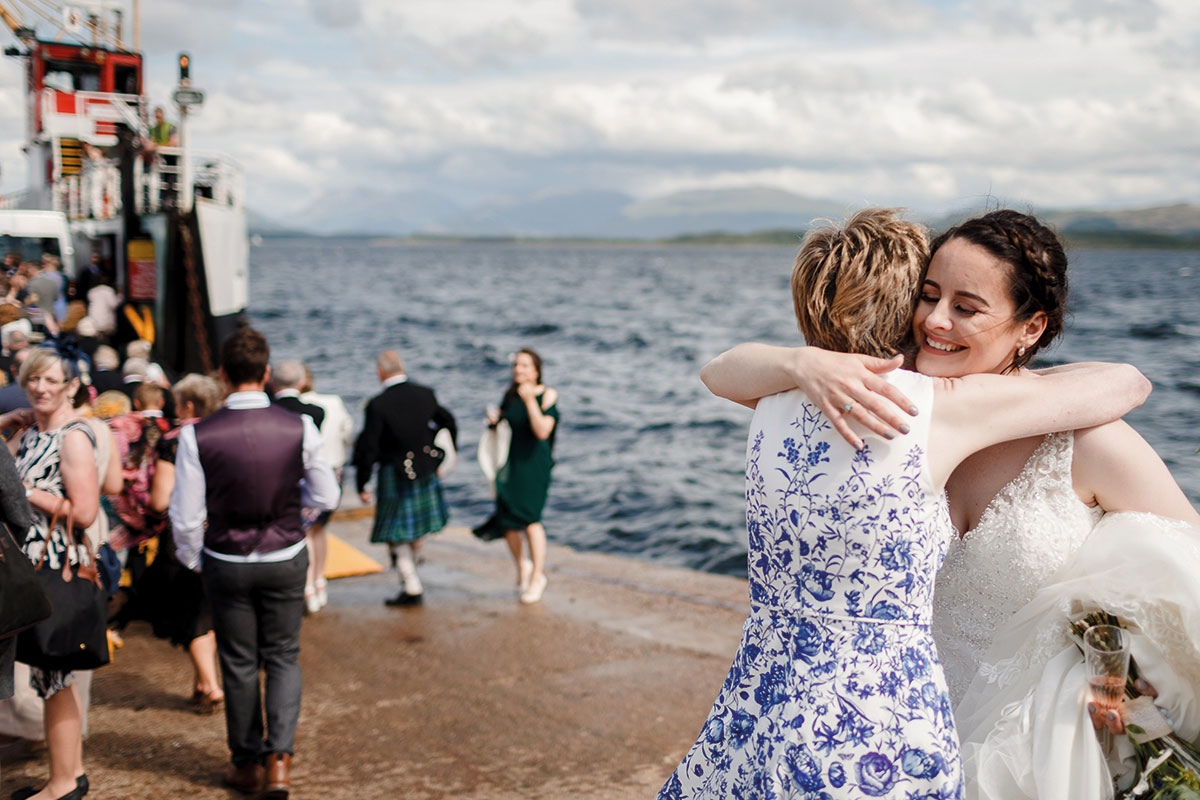 Isle-of-Lismore-Wedding-Photography-Barry-Robb-bride-hugging-guest-on-ferry