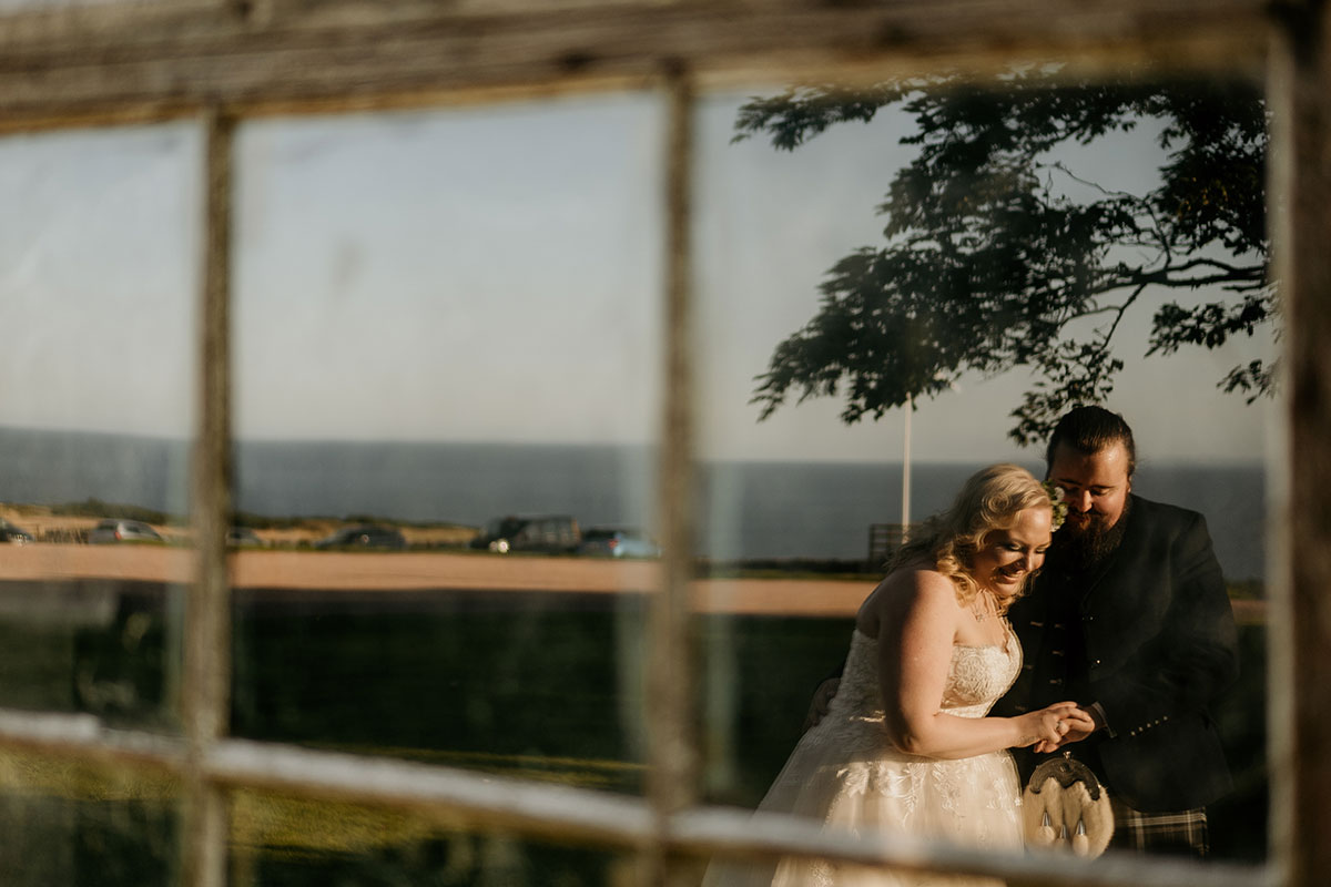 bride-groom-window-reflection-kinkell-byre-victoria-photography