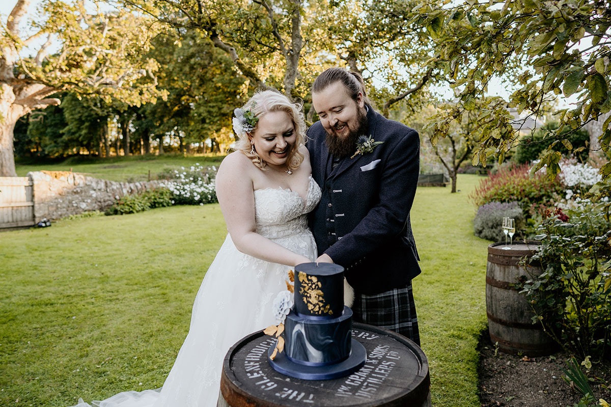 bride-groom-cutting-cake-kinkell-byre-victoria-photography