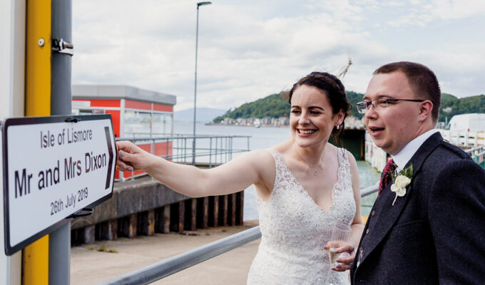 Isle-of-Lismore-Wedding-Photography-Barry-Robb-oban-pier-wedding-sign