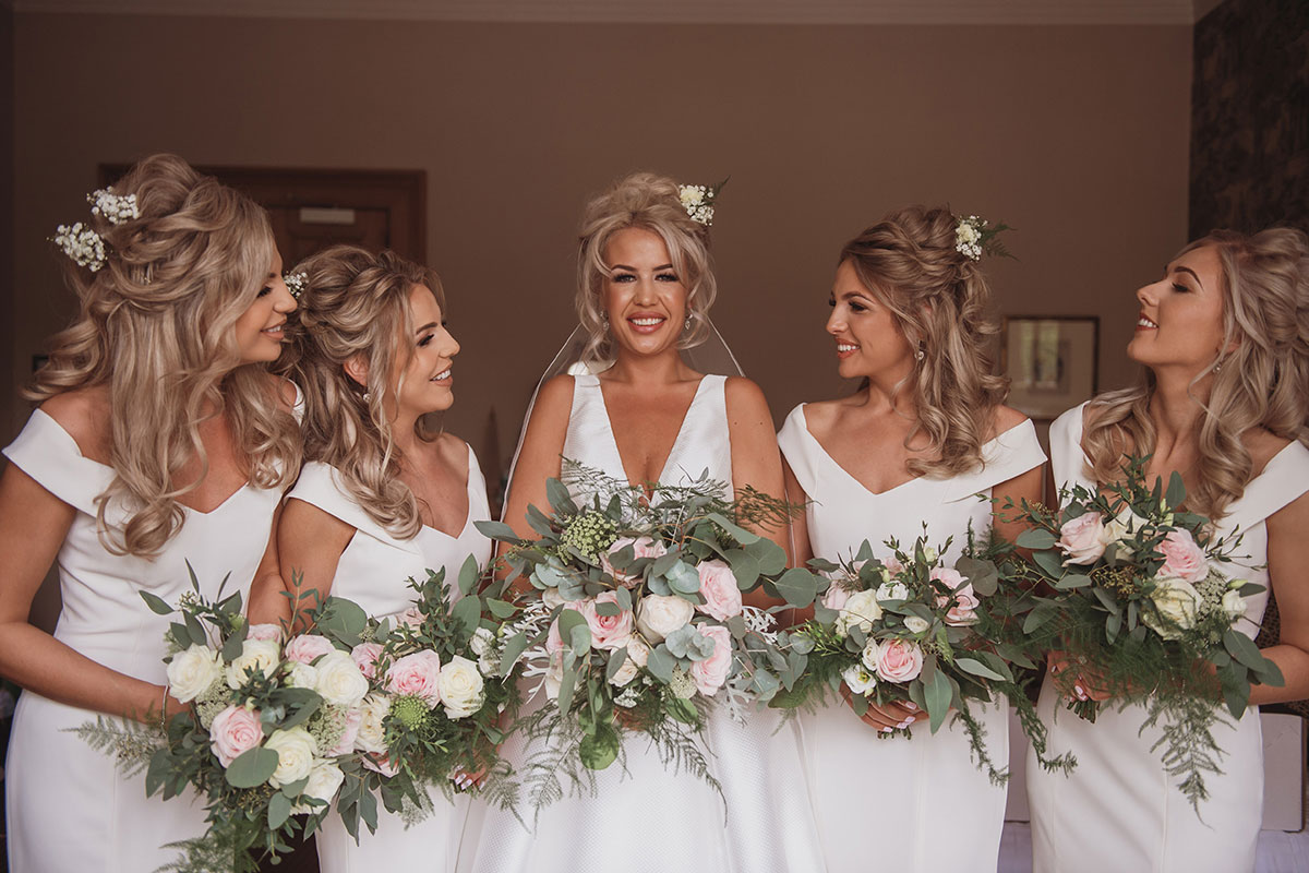 Aboyne Photographics Meldrum House Aberdeen wedding venue bride and bridesmaids wearing white