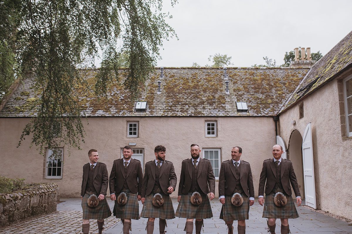 Aboyne Photographics Meldrum House Aberdeen wedding venue groom and ushers outside wearing kilts