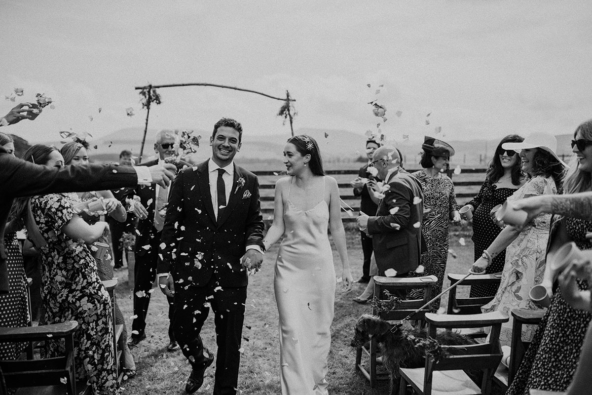 cormiston farm wedding mirrorbox photography bride and groom outside confetti being thrown