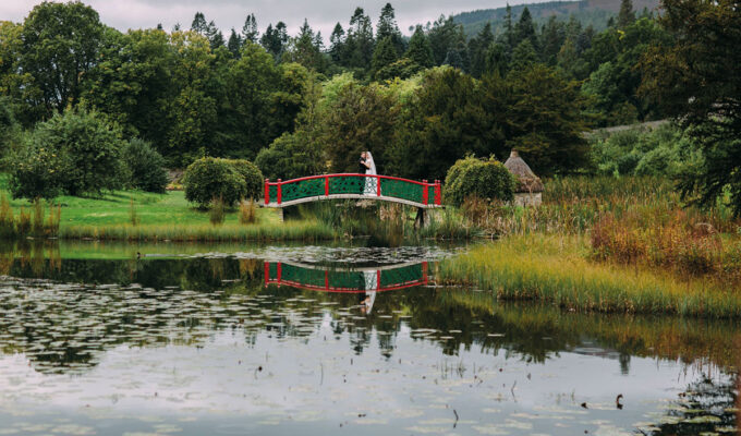 Bride and groom on bridge at Blair Castle