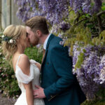 _bride-and-groom-kissing-lilac-flowers-errol-park