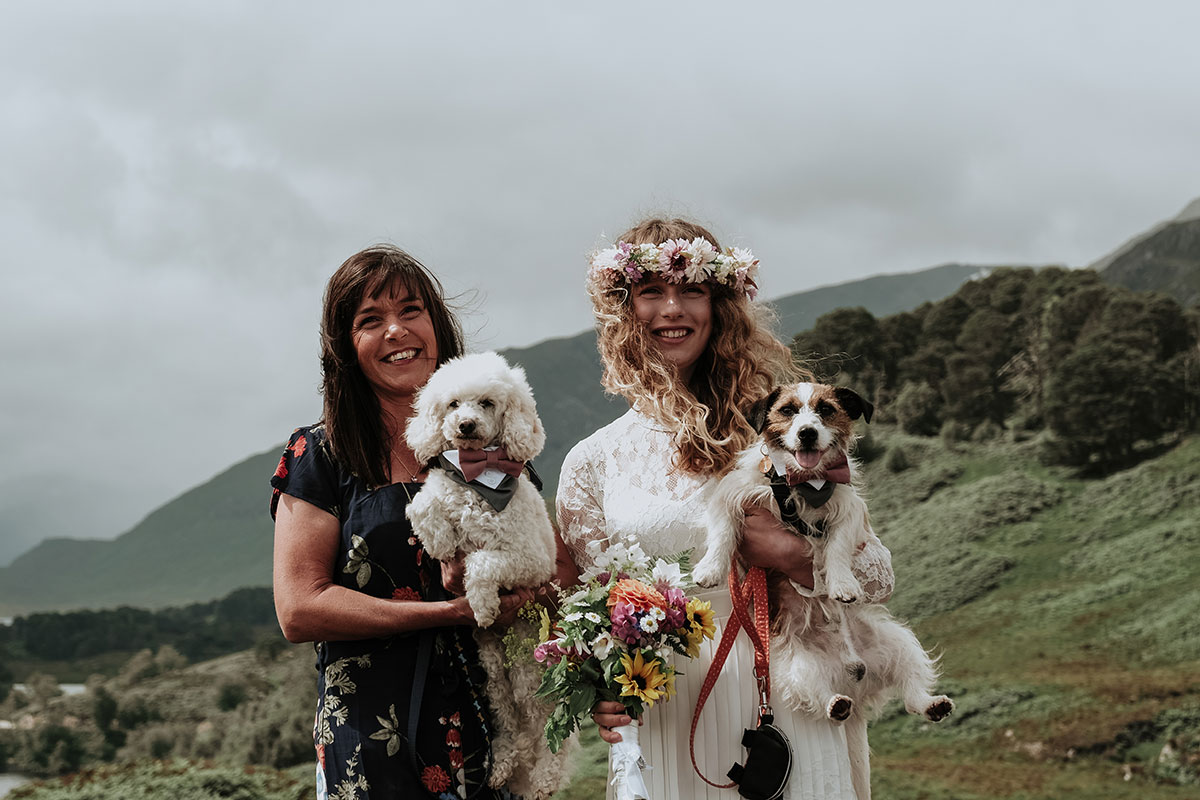 bride and guest with dogs at Glen Affric elopement