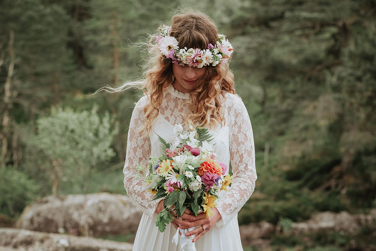 bride wearing floral crown and home picked bouquet in glen affric