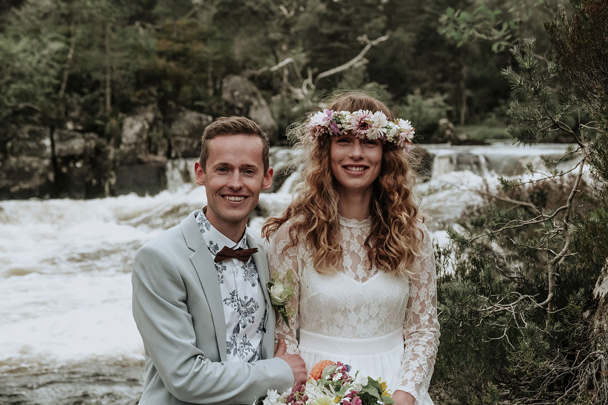 bride and groom by river affric
