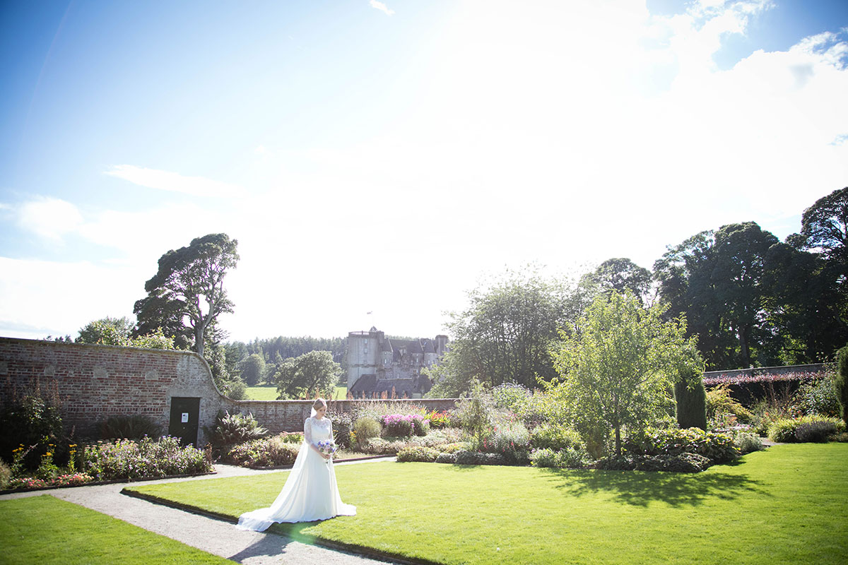 National Trust for Scotland bride in Castle Fraser gardens by Janie Barclay Photography