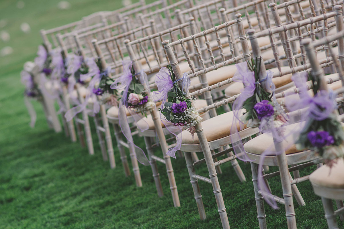 Aswanley wedding ceremony chiavari chairs set outside with lilac flowers and ribbon