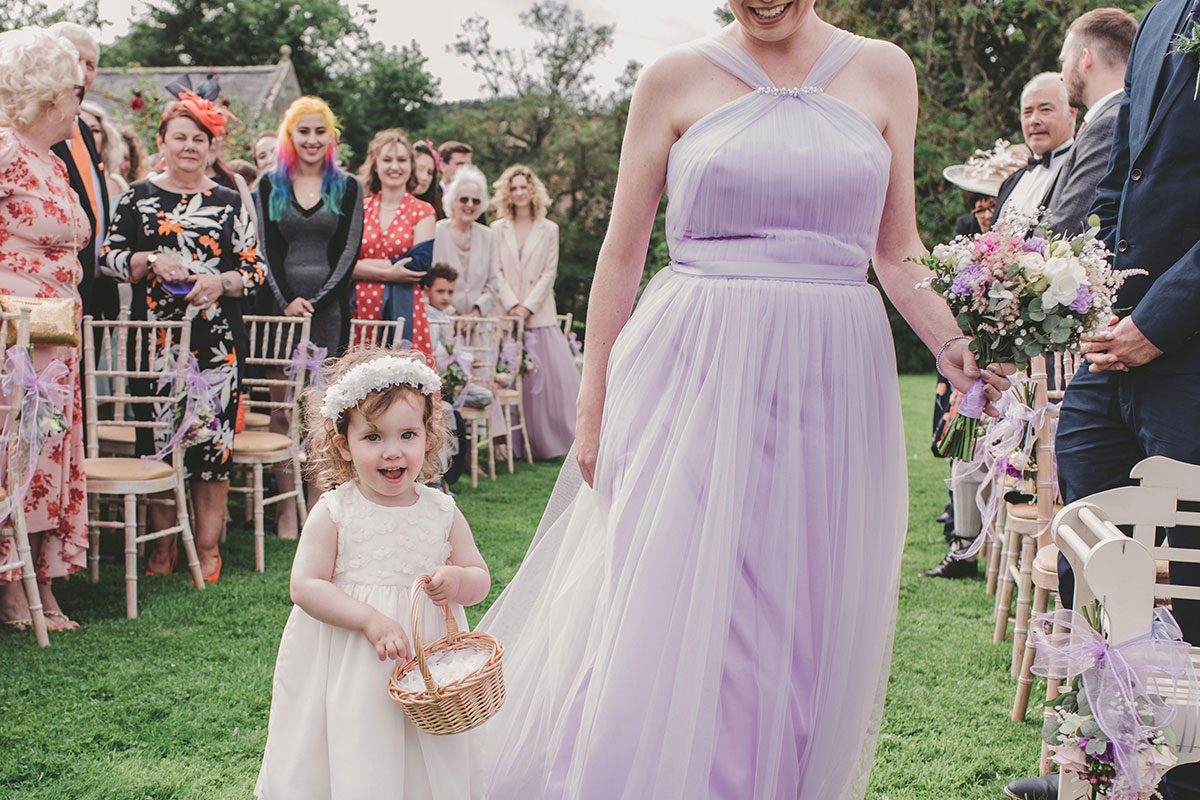 flower girl throwing confetti from basket at Aswanley