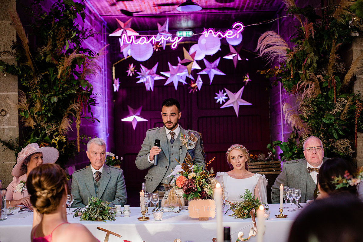 Groom at top table making wedding speech
