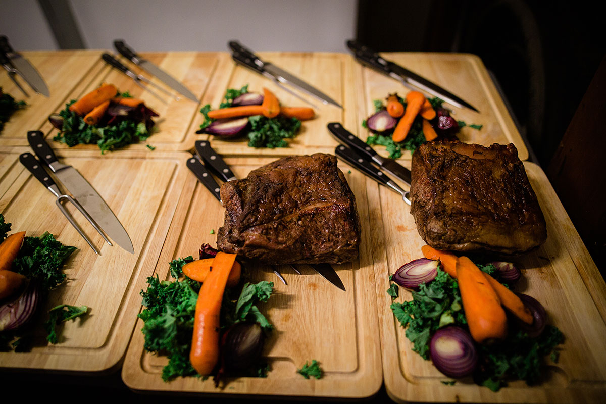 steak and sides on wooden board