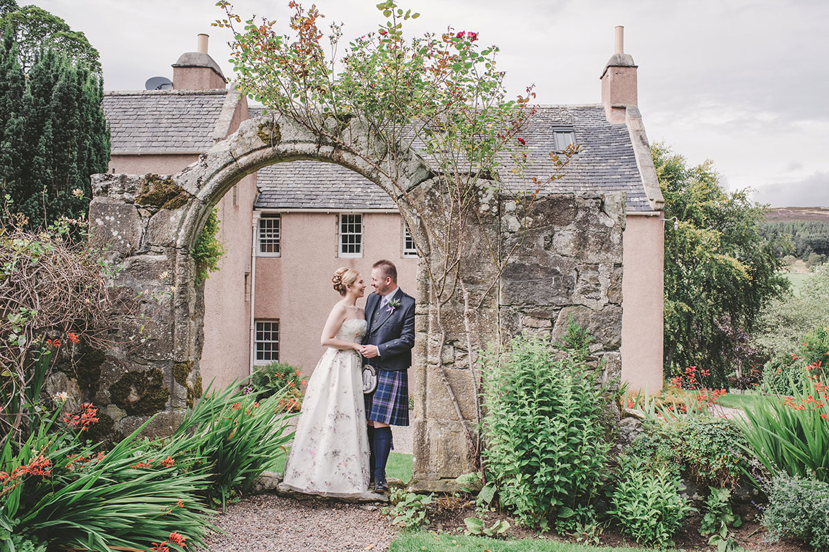 bride and groom in gardens at Aswanley Aberdeenshire wedding venue