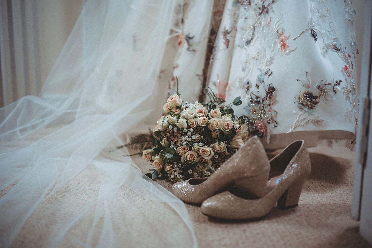 veil shoes bouquet and dress by Zoe Rae Photography