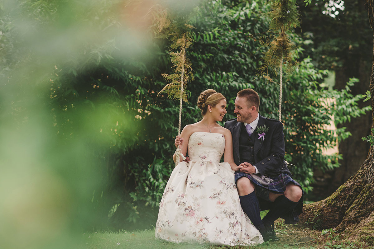 bride and groom on swing at Aswanley Aberdeenshire wedding venue