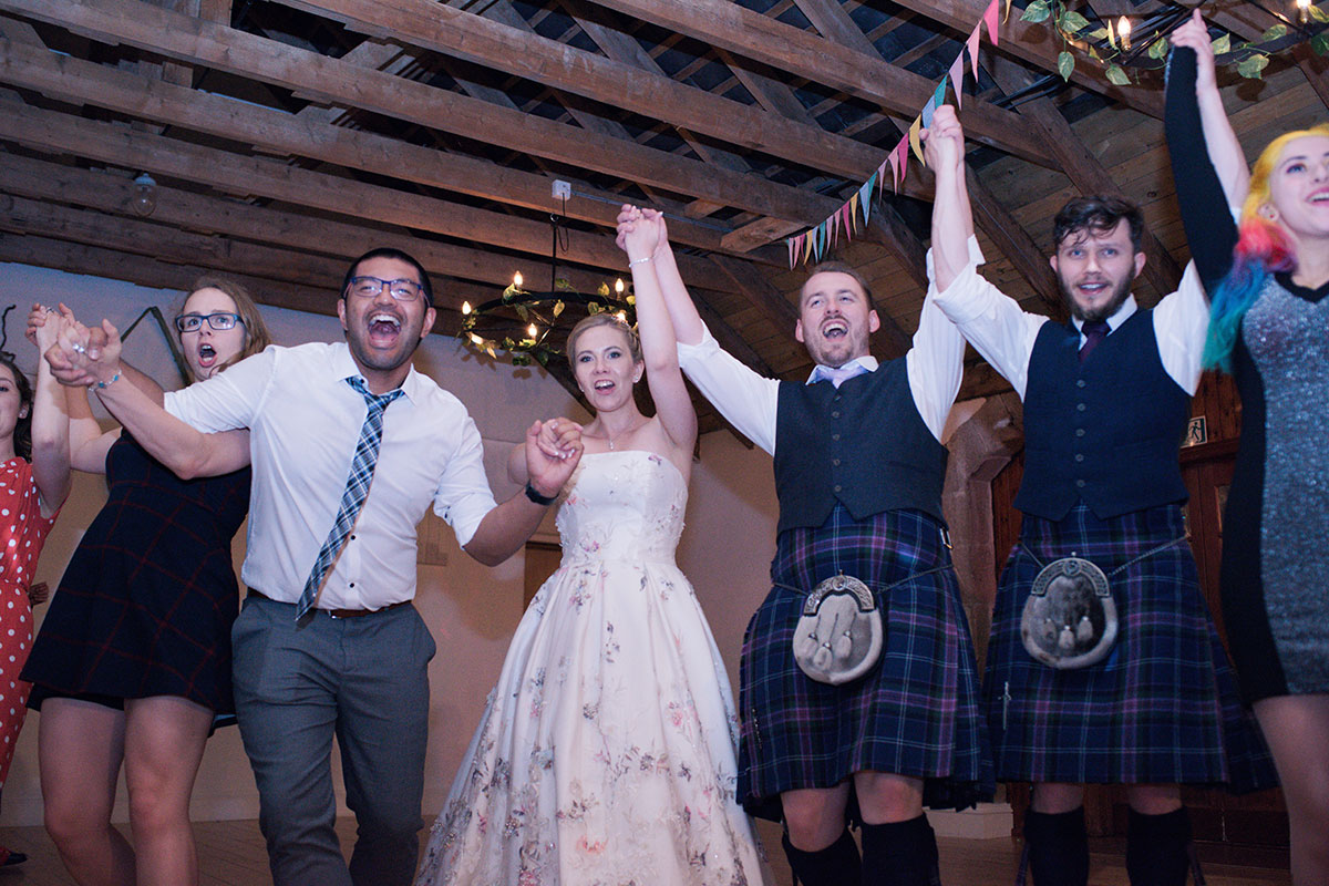 bride and groom ceilidh with guests Aswanley