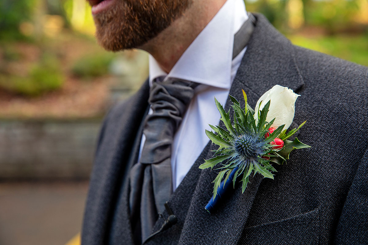 rose and thistle grooms buttonhole