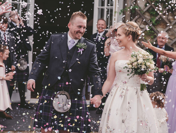 newlywed couple with confetti at Aswanley Aberdeenshire wedding venue Zoe Rae Photography
