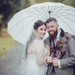 CameraShy Photography-Carlowrie Castle wedding bride and groom with umbrella