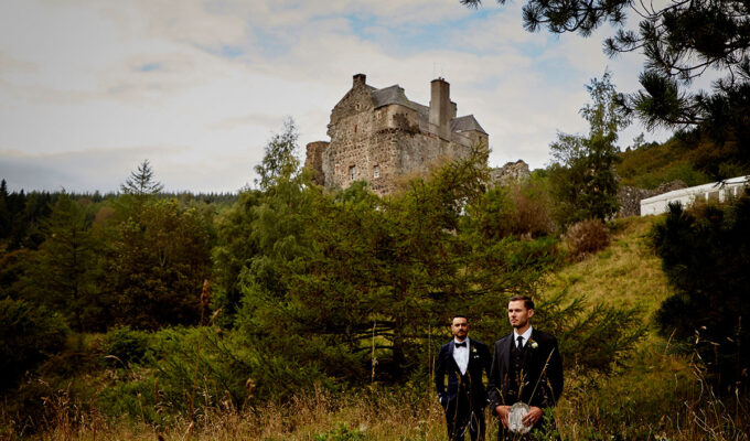 Story of Love Photography two grooms outside Neidpath Castle