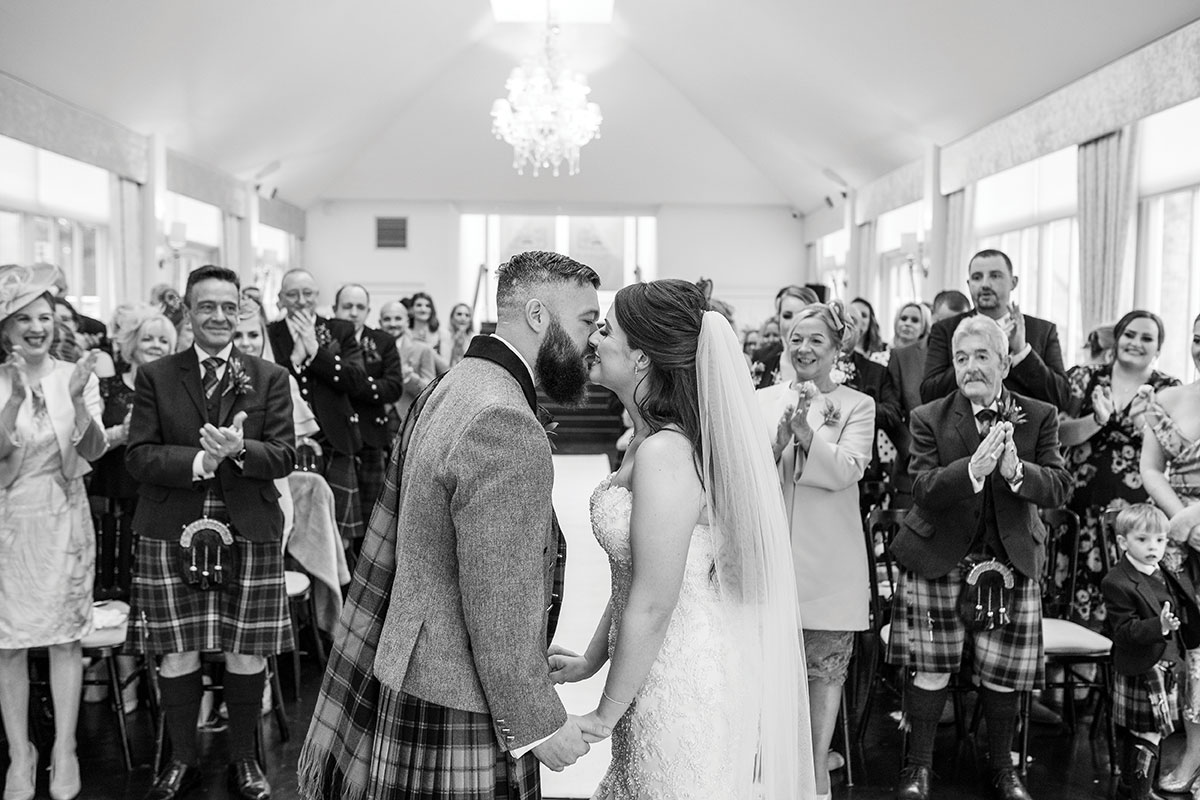 CameraShy Photography Carlowrie Castle wedding bride and groom kiss
