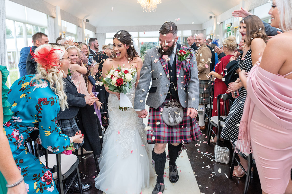 CameraShy-Photography Carlowrie Castle wedding confetti bride and groom