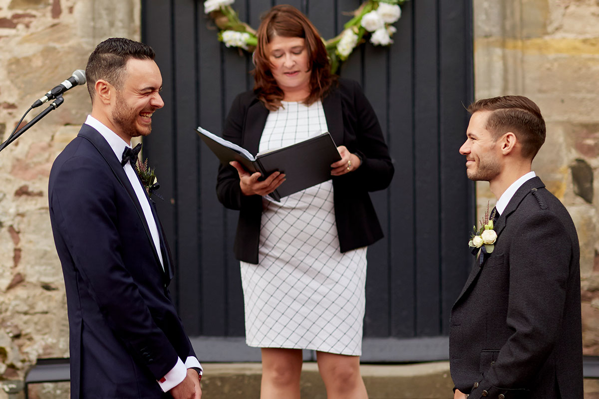 Story of Love Photography two grooms wedding ceremony Neidpath Castle