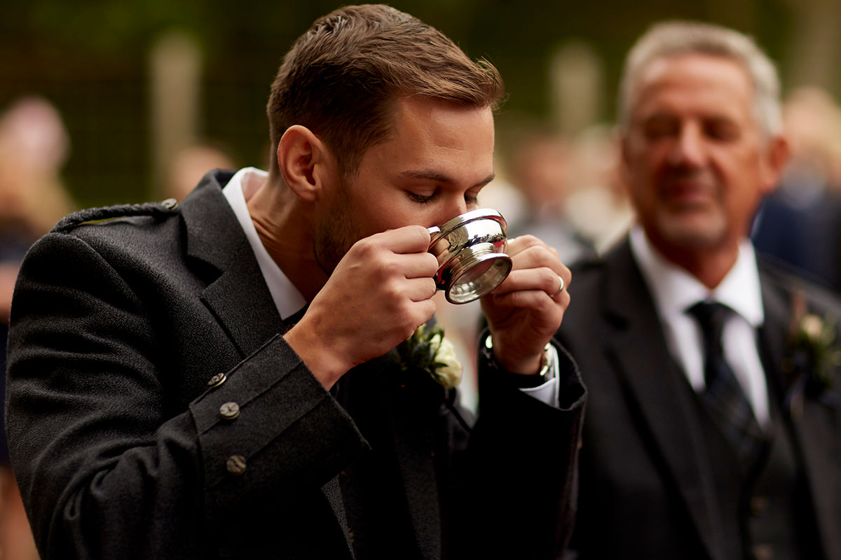 groom drinking from quaich