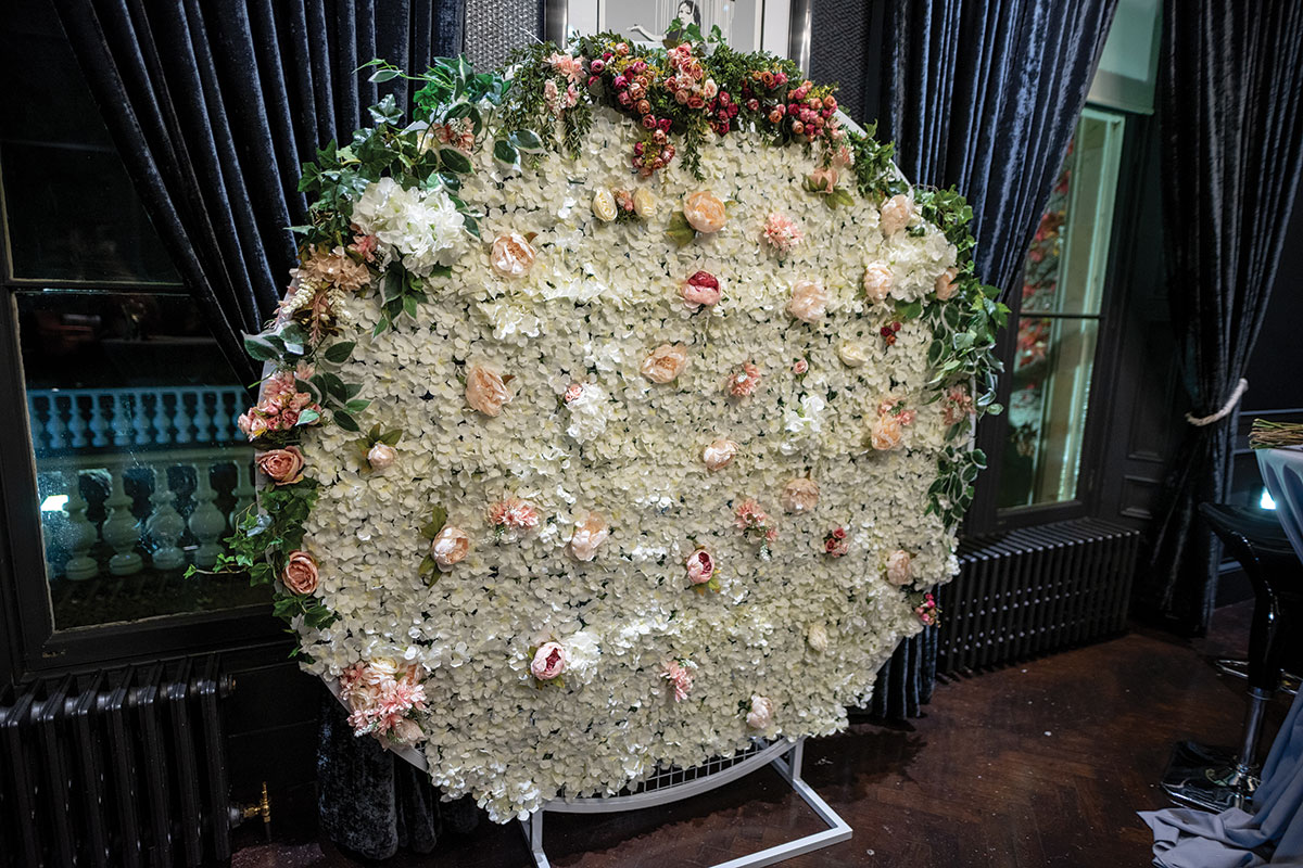 floral wall at Carlowrie Castle wedding