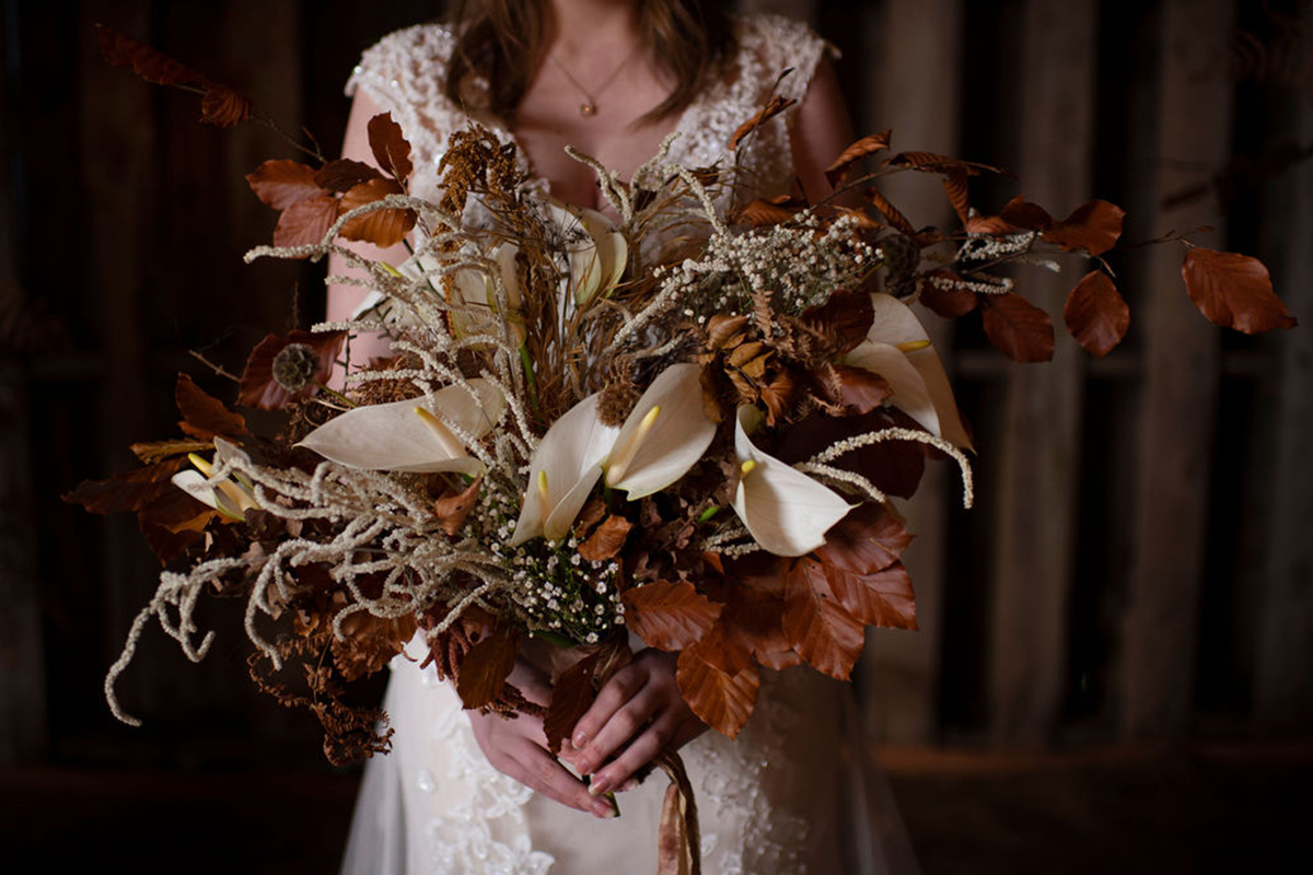 To A Mountain Daisy bouquet with lilies and autumn leaves