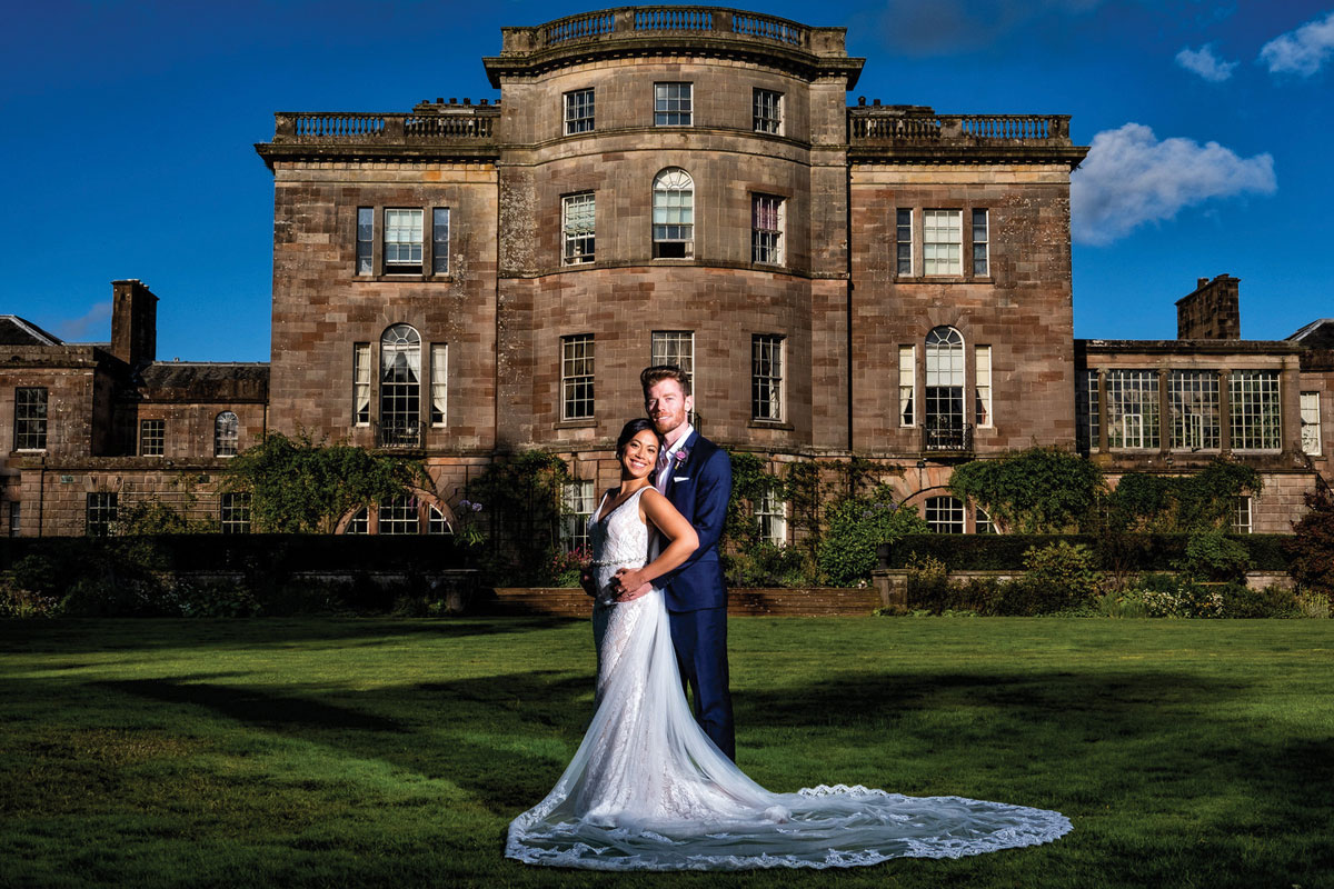 Ardgowan House exterior with bride and groom