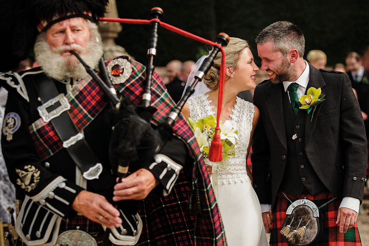 Bagpiper and newlyweds