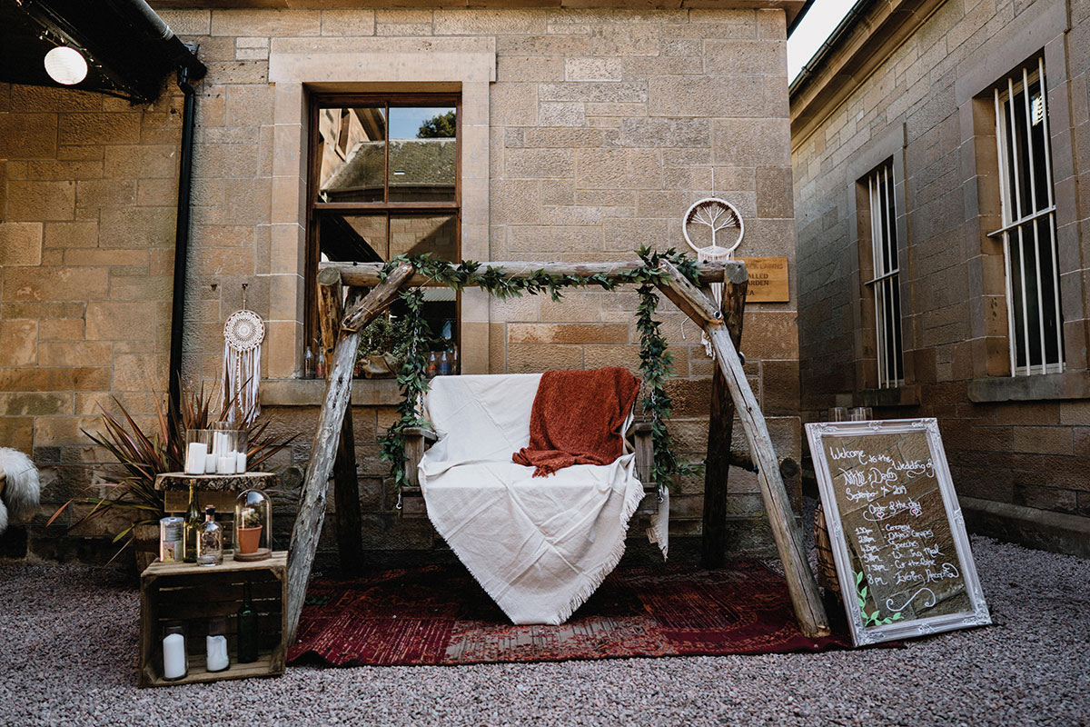 wooden wedding swing and welcome sign at Cambo House