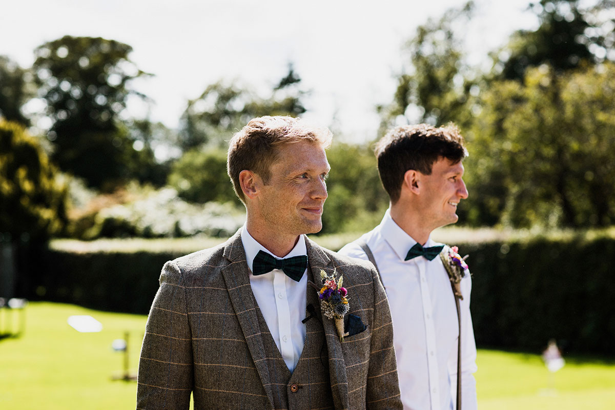 groom and best man outside at Cambo House