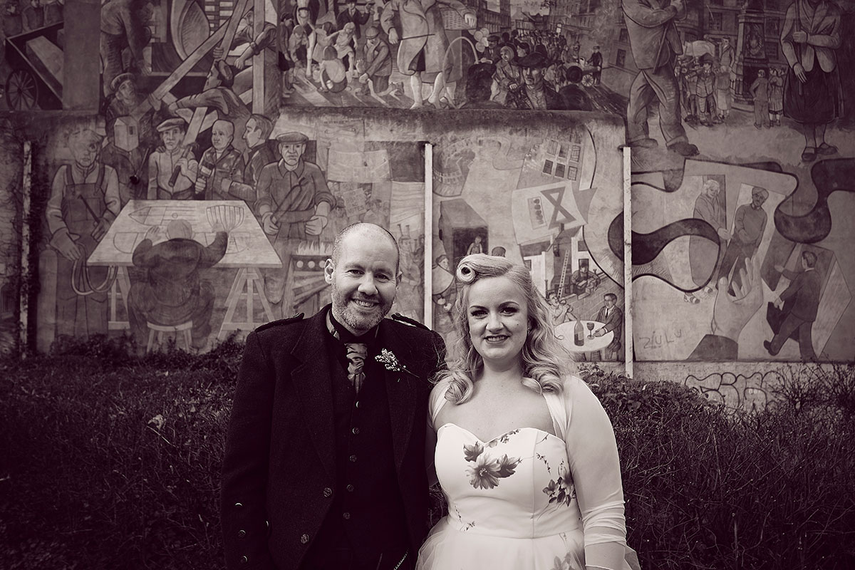 bride and groom at Leith mural