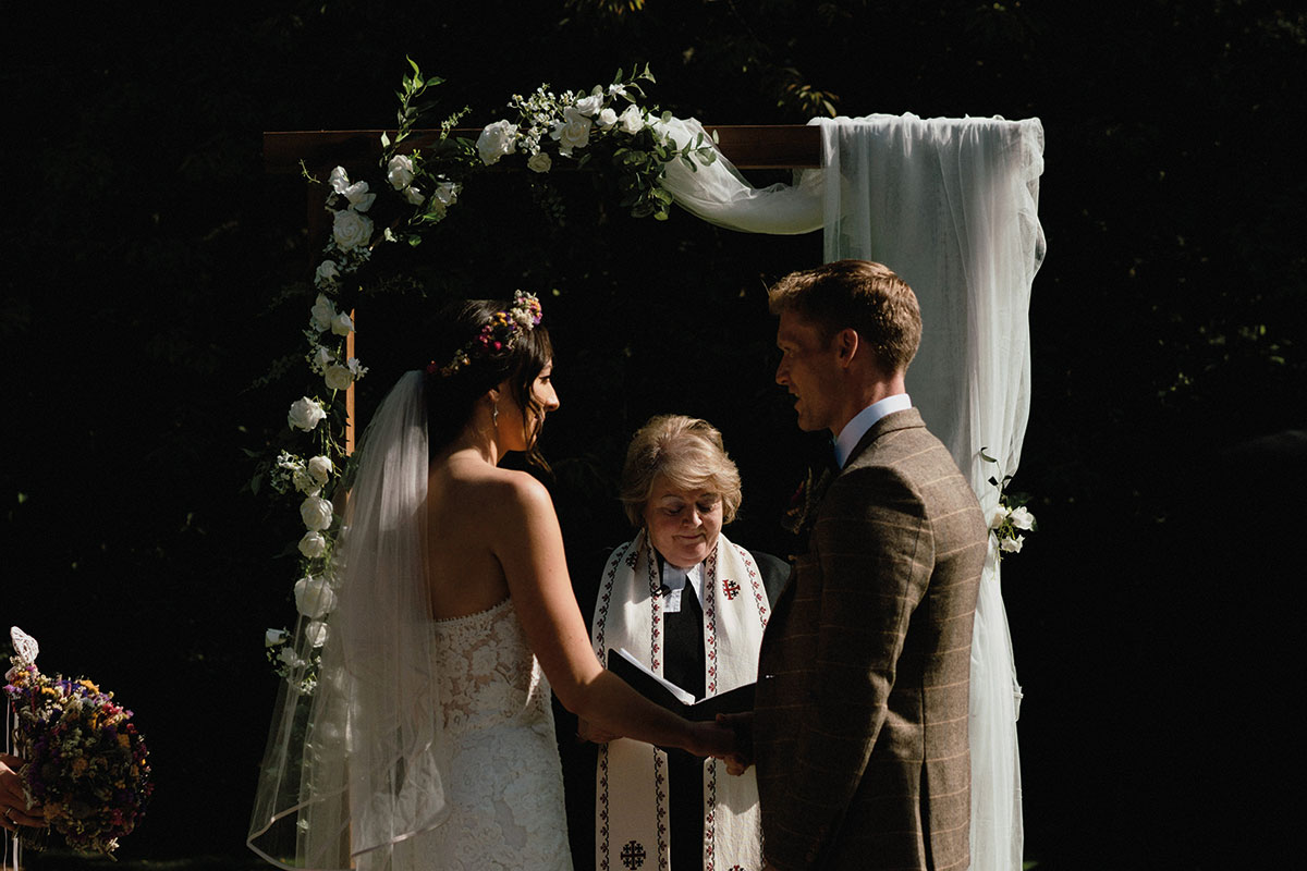 outdoor wedding ceremony with ceremony arch at Cambo House