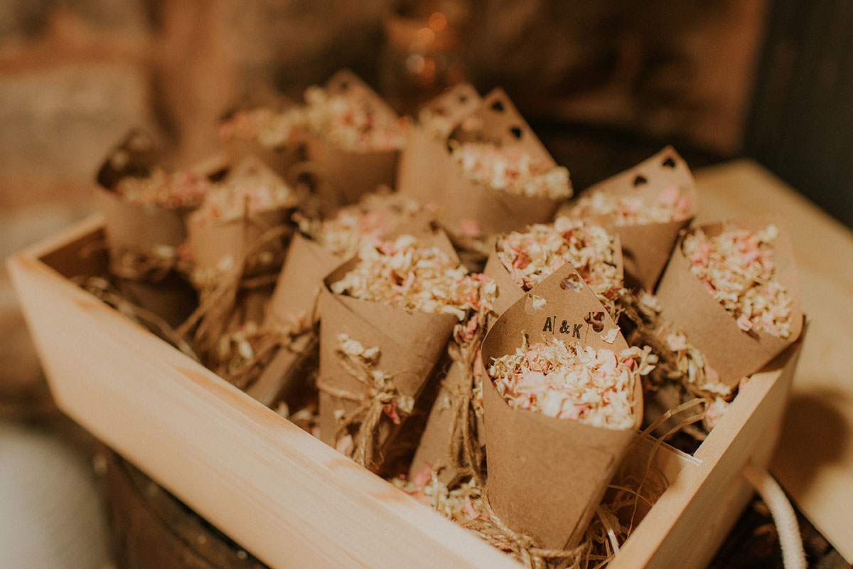 dried petal confetti in brown paper cones and plywood box