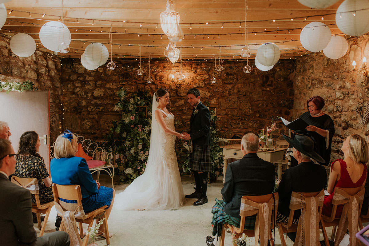 bride and groom during barn wedding ceremony at fruin farm