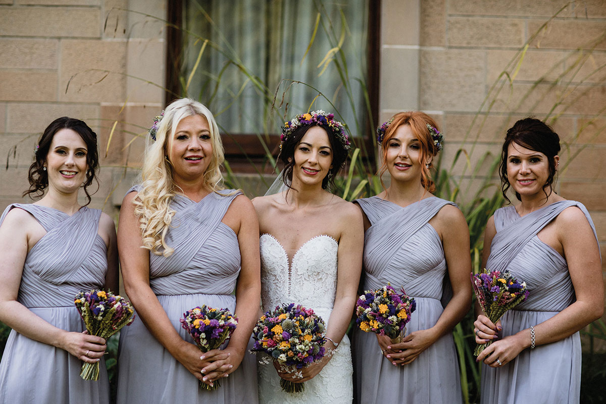 bride with four bridesmaids wearing lilac